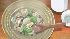 Oysters in a 'sake' based broth and garnished with herbs.