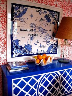 Shock Blue and White Dresser/Console . Blue and White Map Art . Red and White Walls . Color/Mix Overload