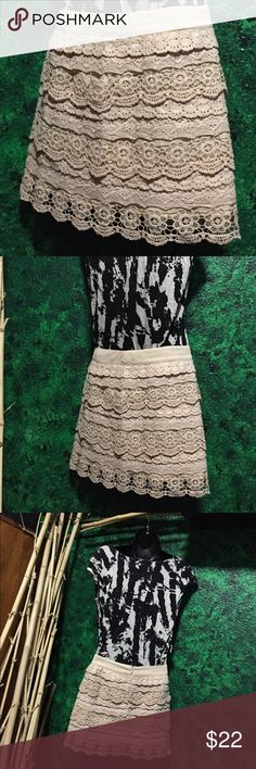 Adorable crochet cream lace skirt XS/S Reposhing this adorable skirt because it is way too small for me ! The tag says it's a small but it definitely fits like an XS or a 0. I couldn't get it to zip up and I usually wear a small or a 5. If anyone sees this skirt in a larger size let me know, because I am in love with it! ;). The lace does have a part that looks torn: photo above. Zipper up the back. Super cute! Tiered crochet lace design, cream/nude color. Francesca's Collections Skirts Mini