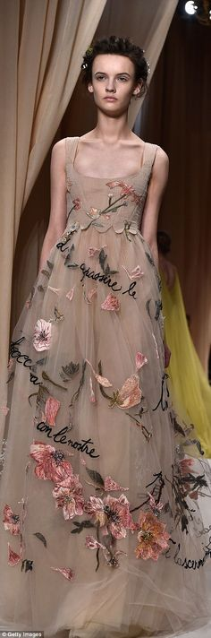 Valentino served up romantic dresses and coats printed with poetic embellishment and hand-stitched motifs