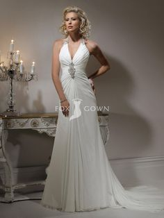 elegant slim gossamer chiffon wedding dress with halter neckline and crystal button closure