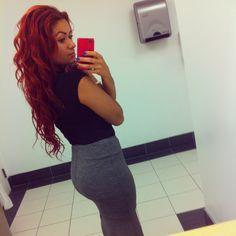 Long red hair curls