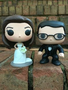 Custom funko pop wedding cake toppers by Customs by Bethany Norris