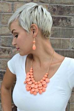 These Teardrop Necklaces come with matching earrings! They are very classy and will add a pop of color to any outfit. They come in 9 colors and measure approx. 22 inches long with an adjustable gold chain. Earrings Measure approx. 2\