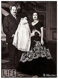 King Farouk I of Egypt With His Second Wife, Queen Nariman Their Baby - March 1952