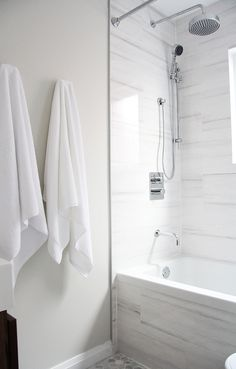 Fixtures. Small bathroom renovation - open up the space using white monochrome palette and modern fixtures.