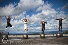 Bridal party jumping at wellington waterfront. PaulMichaels wedding photographers in Wellington. http://www.paulmichaels.co.nz/