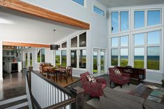Albion Great room. Love the clerestory windows along the top and the tall rake windows at the front. Exposed Douglas fir glu-lam beam is beautiful against the white walls. http://www.linwoodhomes.com/house-plans/plans/albion/