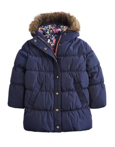 Is this the perfect winter coat? In a new longer length with a zip and poppers to beat the chill, a super-warm faux fur hood and ruching to keep the heat in, we think it just might be. Girls Coats & Jackets, Kids Coats, Joules Clothing, Joules Girls, Barbour Jacket, Girl House, Lifestyle Clothing, Quilted Jacket, Winter Coat