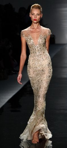Reem Acra - goddess! Cool beige with sparkling elements. Beautful lining. Her skin and hair do pop up because of sparkling fabric and bright lipstick.