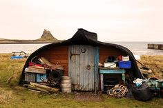 Shed, Lindisfarne, Northumberland | Upturned boat by the seashore |