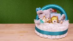 Baby Shower DIY Diaper Gift Basket Baby Shower DIY Diaper Gift Basket,Baby Shower Ideas If you want to set the parents-to-be up right, make this baby shower DIY Diaper Gift Basket, complete with diapers. Diy Diapers, Baby Shower Diapers, Baby Boy Shower, Baby Shower Gifts, Dragon Baby Shower, Diaper Shower, Baby Shower Baskets, Baby Baskets, Baby Showers