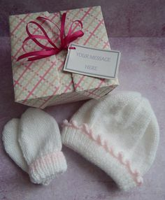 A personal favourite from my Etsy shop https://www.etsy.com/uk/listing/251454423/white-and-pink-baby-gift-set-knitted