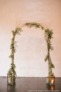 Wedding ceremony arch, simple greenery, seeded eucalyptus, curly willow, lanterns, Ruby