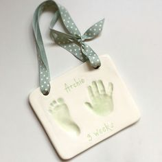 Hanging newborn hand and foot clay imprints. Personalised and hand painted by us.