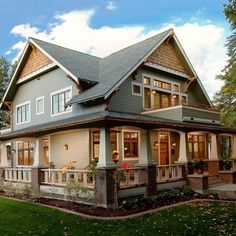 Type of dream home I would love, a Craftsman Style Home. Wrap around porch would be the bees knees!!