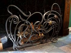 Forged fireplace screen.