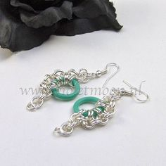 A little self promotion, lovely earrings made with silver plated, good quality rings and soft sea green EPDM rings. You can also look in my shop, there are a few more of these beauties listed.