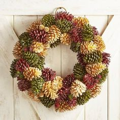 Gorgeous red and white pinecone wreath and poinsettia for Christmas or all winter long Pine Cone Art, Pine Cone Crafts, Wreath Crafts, Diy Wreath, Pine Cones, Acorn Wreath, Felt Crafts, Pine Cone Decorations, Christmas Tree Decorations
