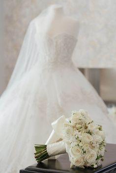 White bridal bouquet in front of wedding dress with trailing greenery by Eddie Zaratsian Lifestyle & Design White Wedding Bouquets, Bridal Bouquets, Wedding Gowns, Wedding Flowers, Rose Flower Colors, Colorful Flowers, White Flowers, Flower Texture, Cascade Bouquet