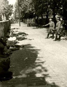 Geiselhinrichtung in Pancevo, Serbia,1941. Hostages being murdered on the sidewalk in Pancevo.