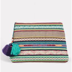 Star Mela Elsa Embellished Purse In Everest: Star Mela was formed in 2007 in London by an ex-fashion buyer and a former model who both love travel, summer and colour. The result is a collection of easy summer essentials that will be your favourites all year round.      Detailed with Peruvian inspired embroidered stripes and zigzag patterns, this large versatile purse is ideal for a multitude of uses, from stashing your beauty essentials to carrying your sunglasses and wallet. Made in jute…