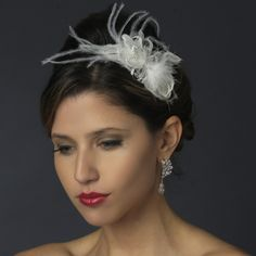 This headband features a wonderful silver plated charm encrusted with dazzling clear rhinestones and with sprays of the most fabulous soft ivory feathers for a vintage style look. Kim's Bridal,  Keywords:   #michiganbridalshop #weddingaccessories #kimsbridal Follow Us: http://www.kimsgiftbaskets.com/ ... https://www.facebook.com/KimsGifts