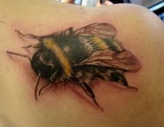 Detailed bumblebee tattoo on shoulder