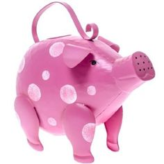 Give your home décor a touch of whimsy with our Pink Pig Handpainted Polka Dot Watering Can. Use this fun and functional garden accessory as charming home décor accent, or fill it with water and use it to water your plants.