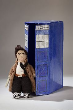 Knitted Doctor Who, as played by David Tennant, with homemade Tardis.