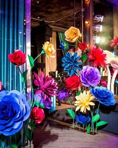 """This was one of our first projects """"Alice in Wonderland"""" with oversized standing paper flowers. I think we have highly improved our handcrafting skills since then and this picture will reflect our professional evolution."""