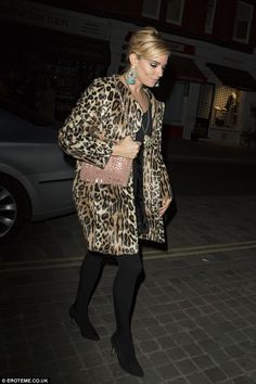 The London look: She kept her legs protected from the chill with a pair of tight and added height to her look with black heels