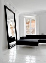 Apartment. Living Space. Black and White. Mirror. Minimalist. Minimalism. Black Sectional. Modern. contemporary. Home. Interior Design.
