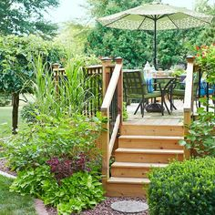 Frame your deck steps using a mix of grasses, plants, bushes, vines, and annuals. They create a great first impression and set the scene for the lavish on-deck plant displays.