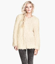 Jacket in soft faux fur with concealed hook-and-eye fasteners at front. Jersey lining.