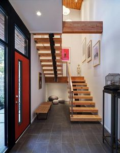 Midvale Courtyard House is a renovation and addition of a mid-century modern ranch house in Madison, Wisconsin, designed by Bruns Architecture. Home Interior Design Images, Home Inside Design, Escalier Design, Casa Patio, Modern Ranch, Wooden Staircases, Modern Stairs, Courtyard House, Staircase Design