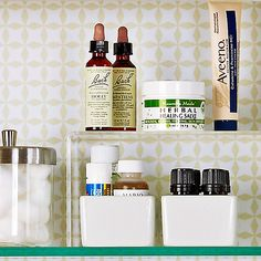 Keep your medicine cabinet organized by placing risers on the shelves to hold shorter bottles.