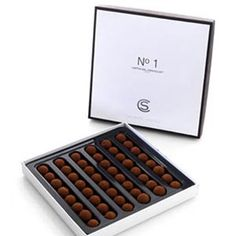 Want to buy chocolate online? Most people have a favourite chocolatier but it was nigh impossible for us chocoholics at delicious. Chocolate Shop, Box Packaging, Boxes, Place Card Holders, Sweets, Desserts, Shopping, Food, Tailgate Desserts