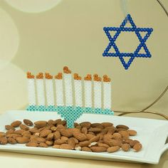 Creating this glittering menorah and Star of David with Perler beads is a wonderful way for a family to celebrate the Festival of Lights. Hama Beads Design, Diy Perler Beads, Bead Crafts, Diy Crafts, Festival Lights, Fuse Beads, Menorah, Star Of David, Beading Supplies