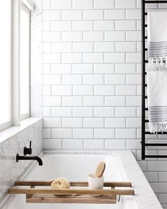 // TILES, TAPWARE ... Action ;) @lloydhartleyarchitects. You WIN Bevelled Subway Tile. You win :) Photo by @jacshooter via @homestolovenz. Team DS. X #designstuff #bathroom #bathroomdesign #bathroominspiration #marble #blacktapware #subwaytiles #whiteonwhite #scandistyle #blacktowelrack #interiors #interiorinspiration #newzealand