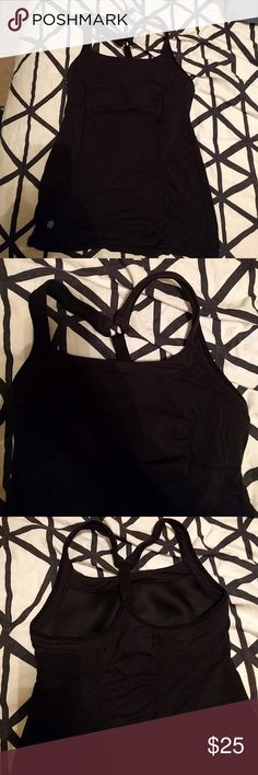 Athleta black workout tank Great workout tank. Gently worn with some pilling near the underarms. adjustable racer back with ruching on the belly and down the back. Very comfortable. Size small, runs a little large. Built in bra. Athleta Tops Tank Tops