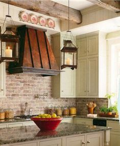 Love everything from the stovetop vent to the brick, cabinets and island