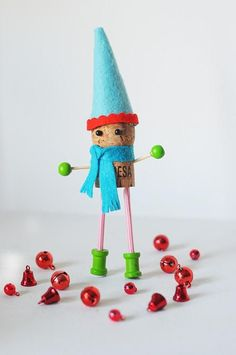 CORK ELVES. See the tiny tiny spools for feet. Now I know a use for them. This is part of 30 CORK ORNAMENTS that are Adorable. Instructions? NO.  Lots of good ideas? YES. To go to next page (on 1st page you MAY need to scroll ALL THE WAY to the VERY BOTTOM.)