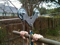 back yard zip line | garage door pulleys connected with two l brackets and held to the ...