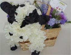 Cow.  Floral animal arrangement made from silk flowers.  Website:  http://epetalsbyelizabeth.com/