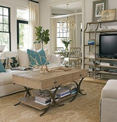 Living Room Coastal Living Room Features Rustic Wood Coffee Table With Drawers Also White Sofa Plus Luxury Chandelier Besides Metal Frame Display Rack Tv Set And Branch With Glass Door Also Rustic Brown Rug Impressive Living Room Decoration Styles That Terrific