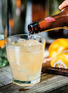 Mean Shandy: 1 3/4 ounces bourbon 1 ounce Lemonade Syrup 1 1/3 ounces beer, preferably lager Ice Lemon slice, for garnish