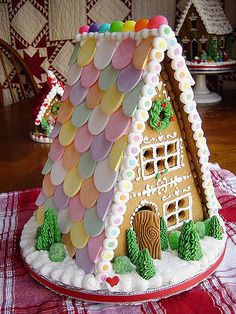 12 Insane Gingerbread Houses We Wish We Could Live In | MODERN LIVING | This simple, elegant design – complete with miniature spruces – is inspired by the postwar A-frame home.