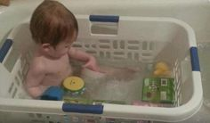 Baby laundry bath! This is one of the best ideas I've ever seen. The baby has something to lean up against, the toys can't get away and it could save countless children from drowning because they have something, besides the slick tub walls, to pull themselves up on in case the fall under the water. Put a towel in the bottom to sit on for anti-skid.