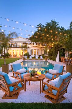 free-form twinkle lights create the ultimate Summer ambiance for your backyard. Add your own twist with a variety hanging lanterns too!